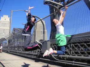 Mariko Kuribayashi jumping for joy with Jui PijaDa at the Global Launch on the Sydney Harbour Bridge