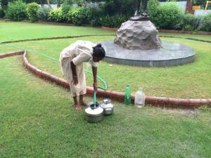 A lady fills her water containers from a hose that is constantly running in a park in Ahmedabad, India. Is this good that she has access to running water, or a concern that she is doing it in a way that is possibly unhygienic? How do we know when change is necessary or even possible?
